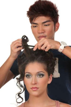 Hair dresser fixing model photo