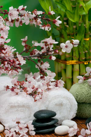 Spa concept with soft towels, bamboo and healing pebbles
