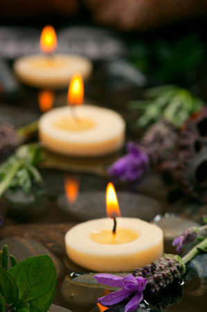 Spa concept with aromatic floating candles, herbs and lavender Zdjęcie Seryjne