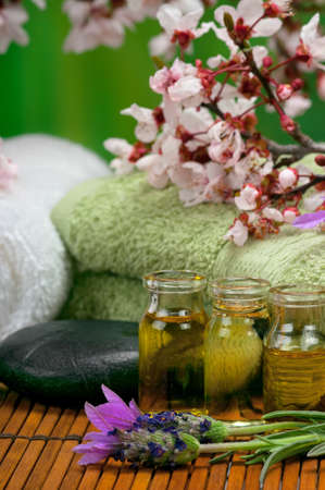 Spa scene with massage oils, lavender and towels