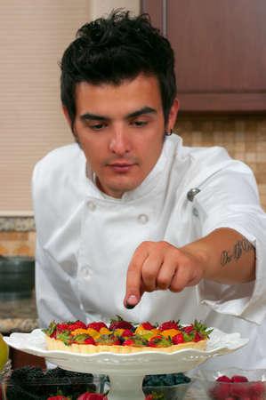 Chef making fruit tarts