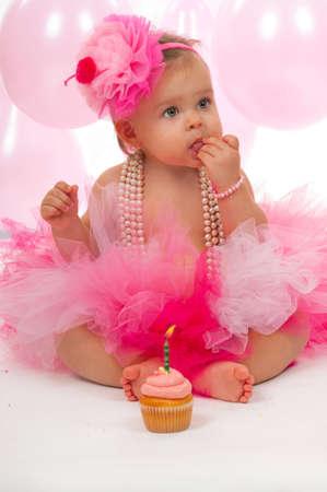 Birthday baby eating her cake