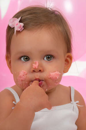 Baby eating her birhtday cupcake