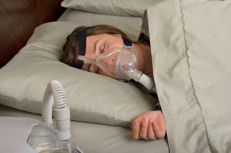 Woman wearing CPAP machine for sleep apnea