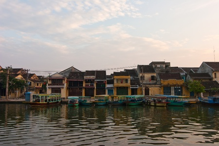 Landscape with boats, ancient house in Hoi An, Vietnam Stock Photo - 19900614