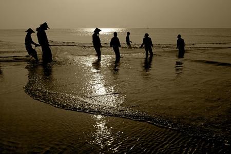 Fishermans dragging fishing nets  photo