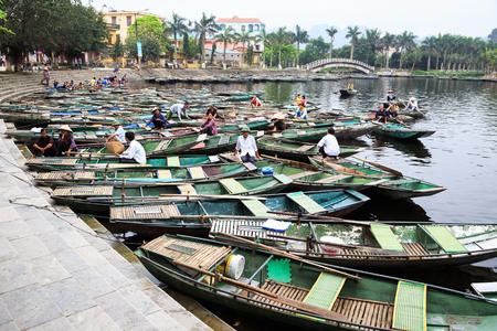 paddler: Ninhbinh,Vietnam, Apr 19, 2014  boats on dock Tam coc- Bich Dong Landscape in Ninhbinh, Vietnam