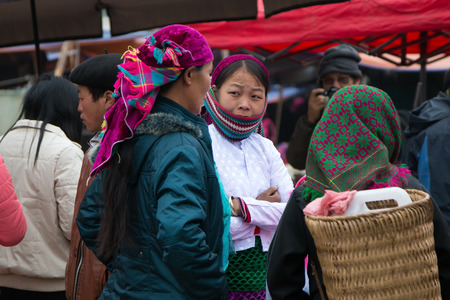 ha giang: HA GIANG, VIETNAM, FEBRUARY 16, 2014  Unidentified ethnic minority women in a traditional market in Ha Giang, Vietnam  Ha Giang is a northernmost province in Vietnam