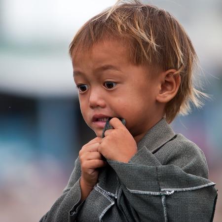 penury: HA GIANG, VIETNAM, FEBRUARY 16  Unidentified ethnic minority children in a traditional market on February 16, 2014 in Ha Giang, Vietnam  Ha Giang is a northernmost province in Vietnam