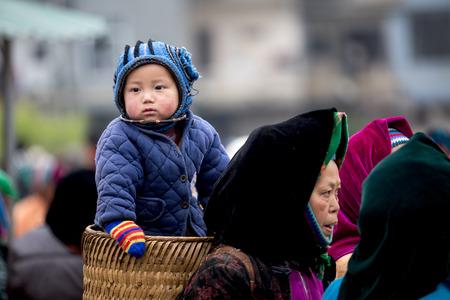 ha giang: HA GIANG, VIETNAM, FEBRUARY 16, 2014  Unidentified ethnic minority women in a traditional market in Ha Giang, Vietnam  Ha Giang is a northernmost province in Vietnam