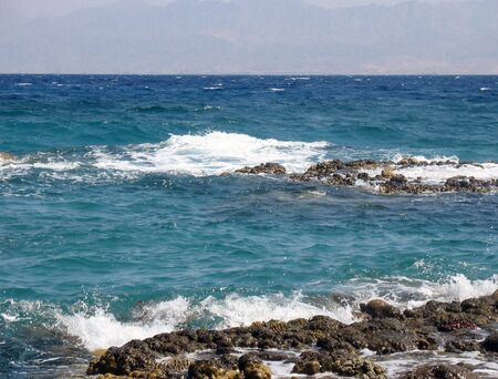 Waves run on coral reeves. Red sea, Egypt, Taba. photo