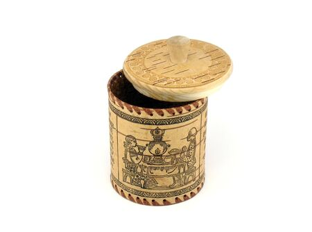 slightly: Saltcellar (sugar bowl) from a bark of a birch with the slightly opened cover. A photo on a white background.