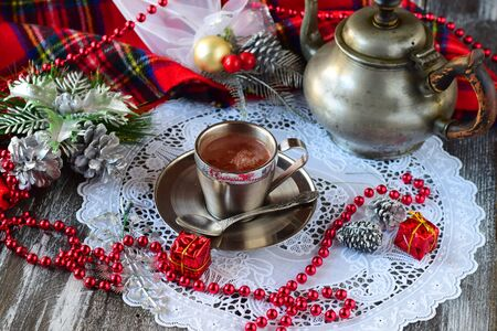 Hot steaming chocolate in a silver cup.