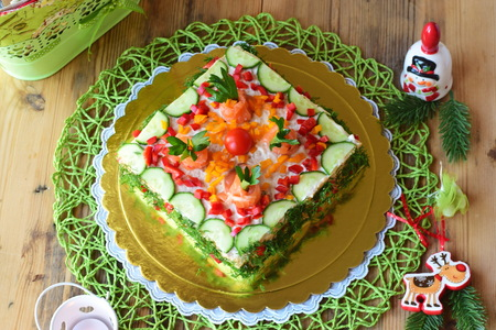 Swedish appetizer tart made with bread, smoked salmon, fresh cucumbers, soft cheese, sweet paprika, dill and cherry tomato Stock Photo
