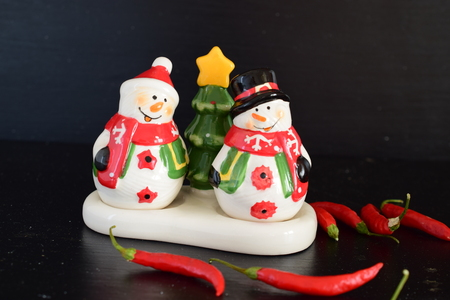 Mr and Mrs Snow man salt and pepper set isolated on black back ground Banco de Imagens
