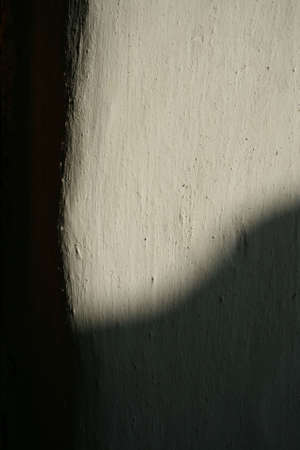The abstract fragment shade on the white clay wall .