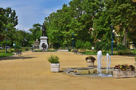 Park in Kiskunfelegyhaza with the statue of an iconic hungarian poet