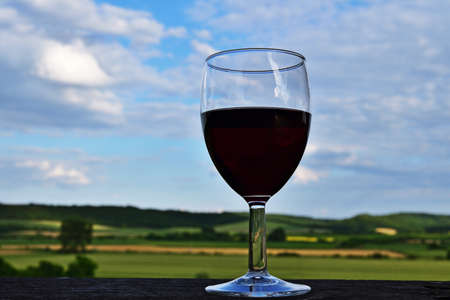 Glass of red wine in rural Hungary