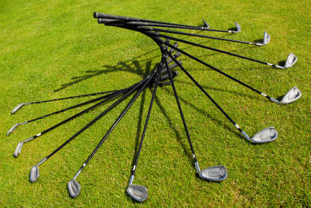Set of golf-clubs arranged in a fan-shape