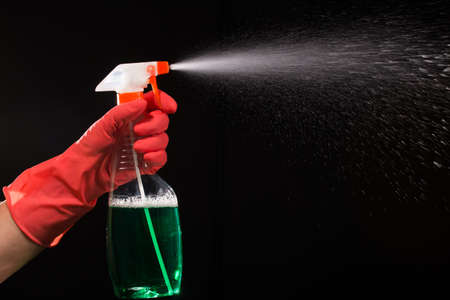 splutter: Spray splashing with green liquid to clean some surfaces in the house Stock Photo