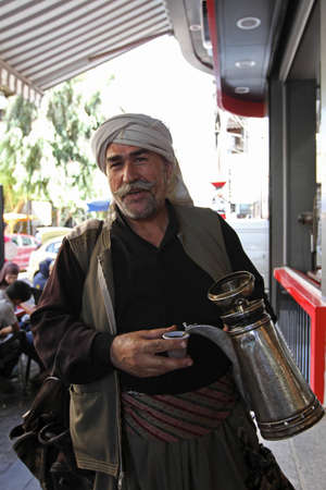 syrian civil war: Damascus, Syria - September 15: A seller of coffee in the streets of Syrian capital on September 15, 2013 in Damascus, Syria