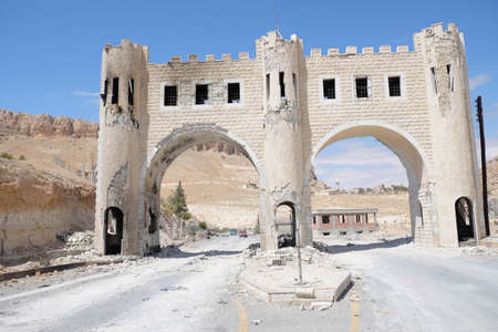 syrian civil war: Maloula, Syria - September 18: A damaged arch entry to Maloula town during Syrian civil war on September 18, 2013 in Maloula, Syria