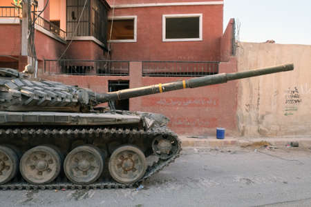 syrian civil war: Damascus, Syria - September 21: A tank of the Syrian National Army in the outskirts of Damascus on September 21, 2013 during Syrian civil war