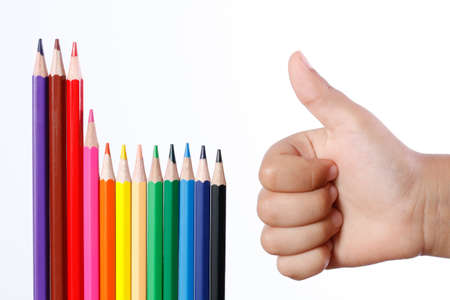 man's thumb: Color pencils and a mans hand with his thumb up