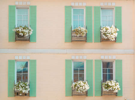 Windows of a pastel colored house in the old part of Kyiv, Ukraine