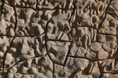 overbuilding: Polygonal setting stone wall background