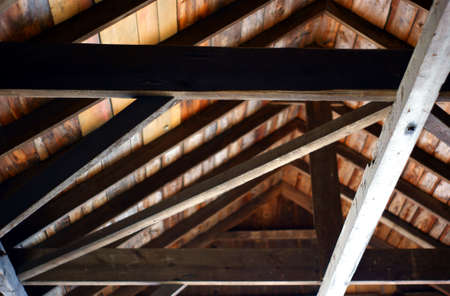 Nice picture of antique wooden beams inside a covered bridge in Central Maine. Banco de Imagens