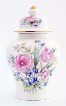 gold top: ginger jar with a floural motiff.  Roses and other colorful flowers adorn the front of the jar, the lid has a gold top and a gold rim.