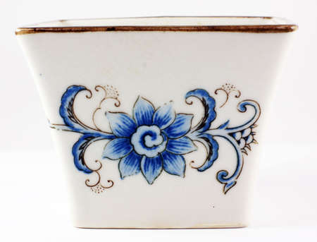 stoneware: Ornate stoneware ceramic bowl with a flower motiff on all sides and a gold colored band on the top.