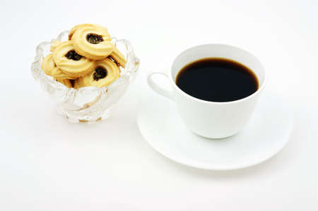 Coffee and delectable fruit filled biscuits for a break. Stock Photo