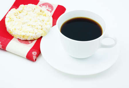 Coffee with a low calorie snack of a rice cake with a napkin.  Stock Photo
