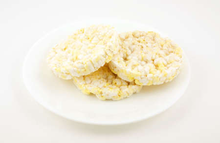 Low calorie rice cake snack on white serving dish. Stock Photo