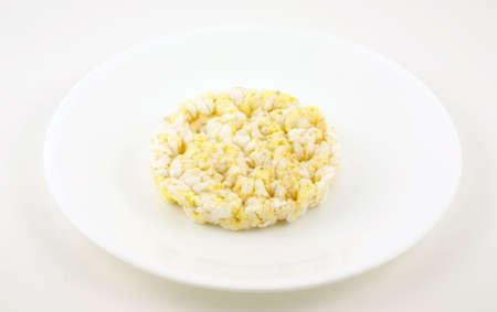 Low calorie rice cake on white dish Stock Photo