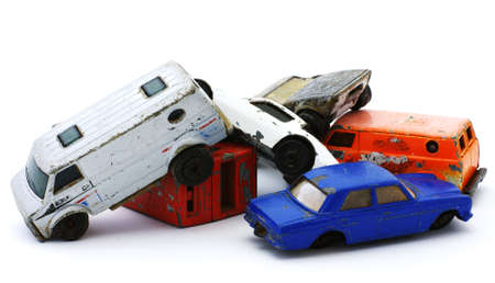 Group of old toy cars in a total wreck. Funny. photo