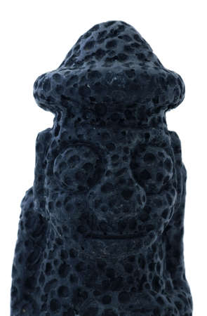 pot belly: Tiki statue made from volcanic lava  Stock Photo