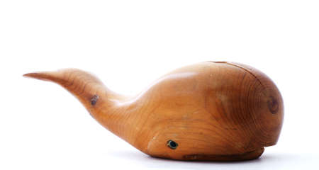 flukes: Nice carved wood whale with flukes elevated.