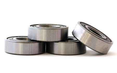 Group of four round stainless steel ball bearings.