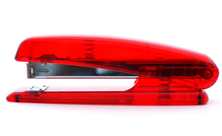 office stapler: Red translucent office stapler with visible mechanism inside.  Stock Photo