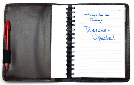 daily planner: A leather daily planner with a resume reminder.