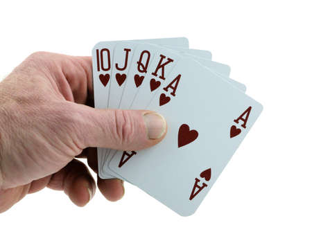 Mans hand holding a royal flush in hearts.  photo