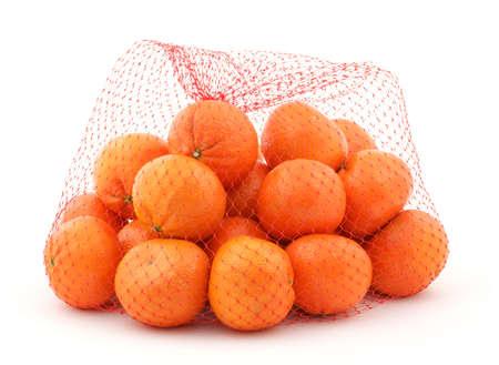 mesh: Very fresh mandarin oranges in a red mesh bag.  Stock Photo