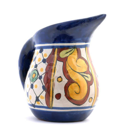 Quite colorful ewer with handle and pointed spout.  Foto de archivo