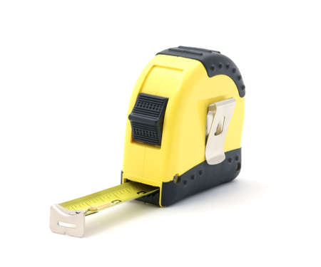 Bright yellow tape measure with inches showing.  photo