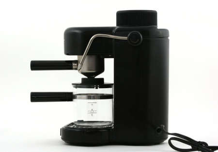 Side view of the common household espresso machine with glass carafe.