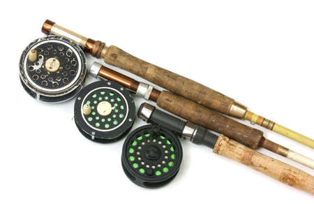 Three old fly fishing rods and reels  photo