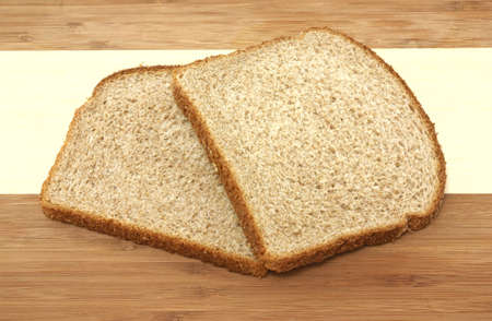 Two slices whole wheat bread on cutting board